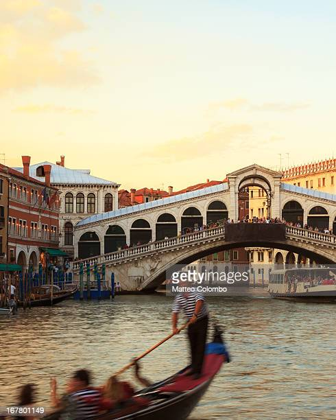 Gondola moving in front of Rialto bridge, Venice