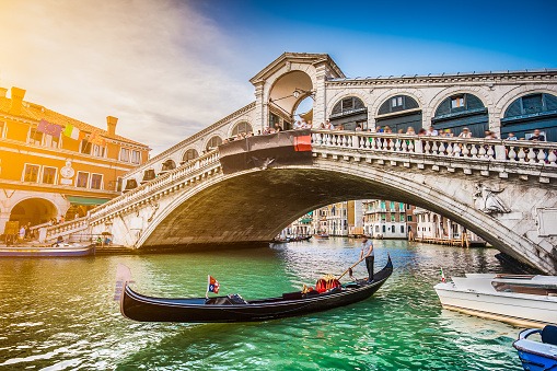 Gondola on Canal Grande with Rialto Bridge at sunset, Venice 488415298