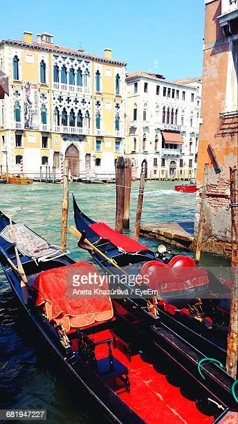 Gondola On Grand Canal Against Buildings In City