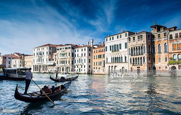 Gondola On Grand Canal By Residential Buildings