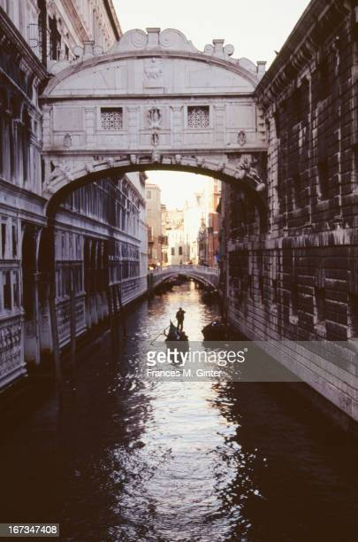 A gondola passes by through Castello in Venice Italy April 1991