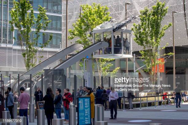 Gondola riders glide up to the rooftop park at the $2 billion dollar Salesforce Transit Center Monday July 1 nine months after it was closed to...