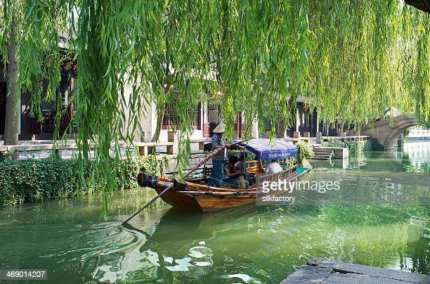 Gondola-like boat on canal in Chinese water city