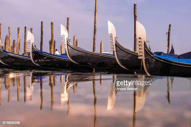gondolas along canal, grand canal, venice, italy - venise photos et images de collection