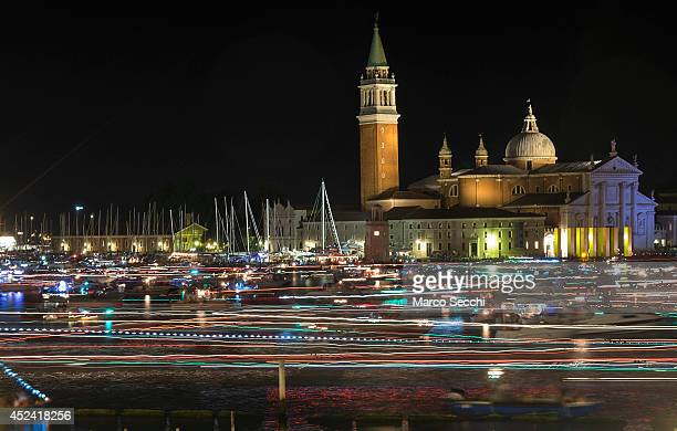 Gondolas and boats are captured on a long exposure leaving St Mark's Basin after the fireworks display for the Redentore Celebrations on July 19 2014...