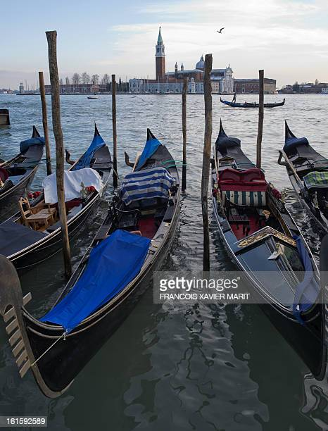Gondolas are at quay on the last day of the carnival on February 12 2013 in Venice AFP PHOTO / FRANCOIS XAVIER MARIT