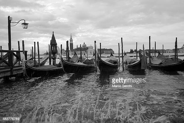 VENICE ITALY APRIL 8 Gondolas are moored in Saint's Mark basin on April 4 2014 in Venice Italy Venice was one of the most popular touristic...