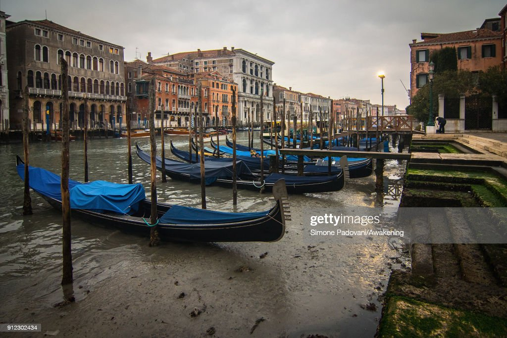 Gondolas are stucked along the Grand Canal near Rialto bridge because of an exceptional low tide on January 30, 2018 in Venice, Italy. An exceptional low tide affected Venice this afternoon creating problems in transport and navigation.