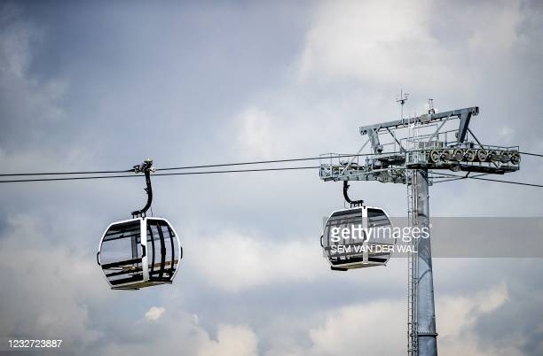 Gondolas hang on the 850 meter long cable, which will transport visitors over the A6 highway to the Floriade 2022 horticultural exhibition center in...
