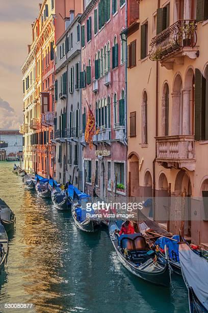 Gondolas in a small channel of Venice