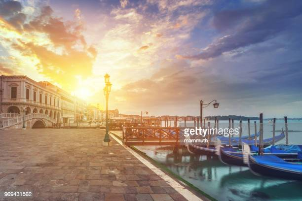gondolas in venice at sunrise - moored stock pictures, royalty-free photos & images