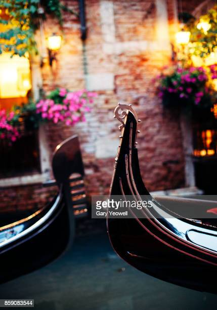 gondolas in venice canal at night - gondola traditional boat stock pictures, royalty-free photos & images
