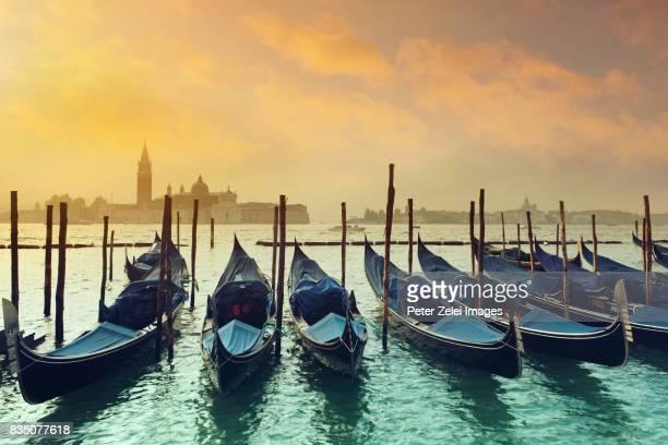 Gondolas in Venice, Italy at sunrise