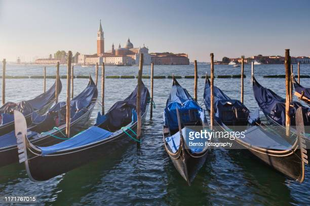 gondolas in venice with san giorgio maggiore church. san marco, venice, italy - gondola traditional boat stock pictures, royalty-free photos & images