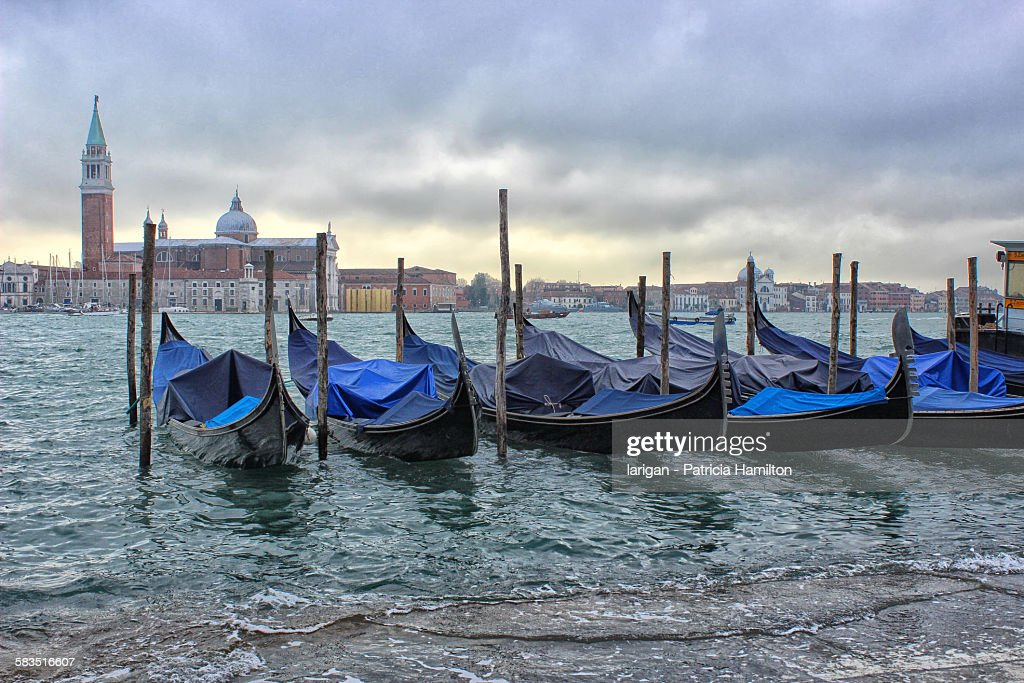 Gondolas on flooded waterfront, Venice : Stock Photo