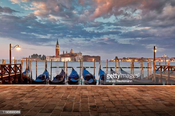 gondolas on grand canal with church of san giorgio maggiore in the background, venice, veneto, italy. - venice italy stock pictures, royalty-free photos & images