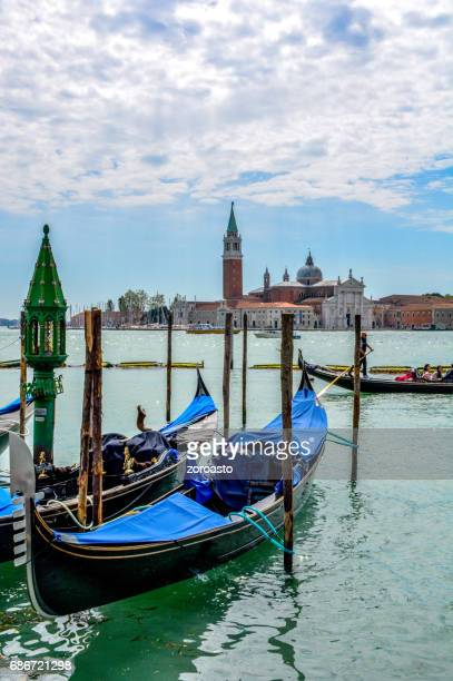 Gondolas parked at their moorings on the Grand Canal in Venice
