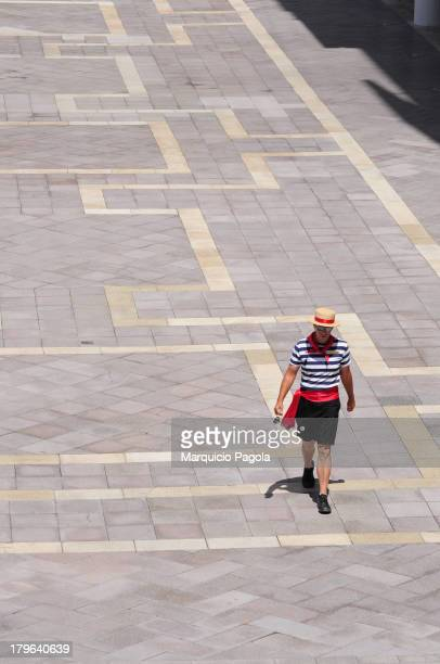 Gondolero walking over the replica Piazza San Marcos square in Venecia. This is located at the entrance of the hotel & casino The Venetian in Las...