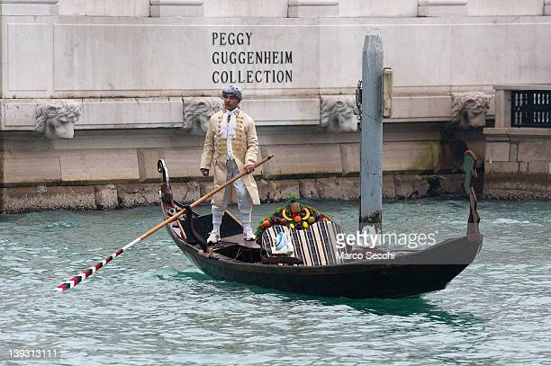A gondolier dressed in period costume crosses the Grand Canal in front of the Peggy Guggenheim on February 19 2012 in Venice Italy The annual...
