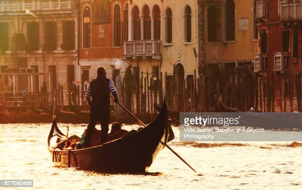 Gondolier on the Grand Canal at Sunset in Venice, Italy