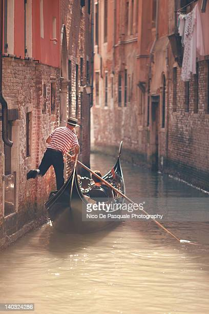 gondolier riding gondola in venice - nico de pasquale photography stock pictures, royalty-free photos & images