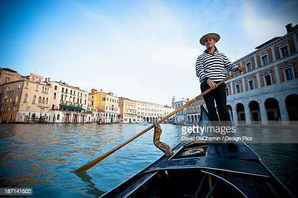 a gondolier rowing a gondola - canal stock pictures, royalty-free photos & images