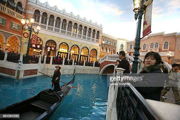 February 24: A gondolier sails on a fake canal under a fake sky at the Venetian casino's shopping mall on February 24, 2008 in Macau, China. The...