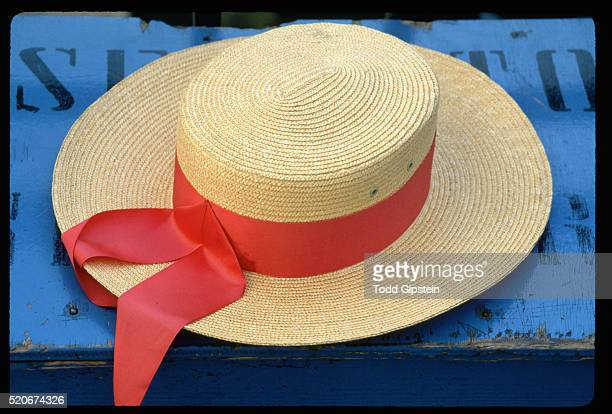 gondolier's hat with a red ribbon - straw boater hat stock pictures, royalty-free photos & images