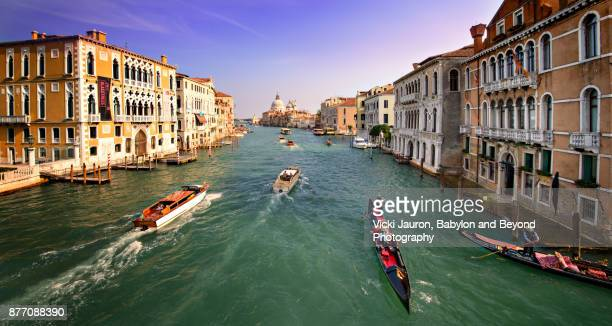 Gondoliers on the Grand Canal in Venice Italy