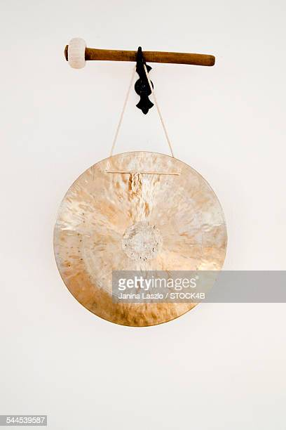 gong hanging at wall - gong stock photos and pictures