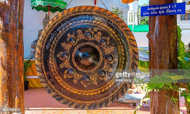 a gong hung up in wat pha bong - gong stock photos and pictures