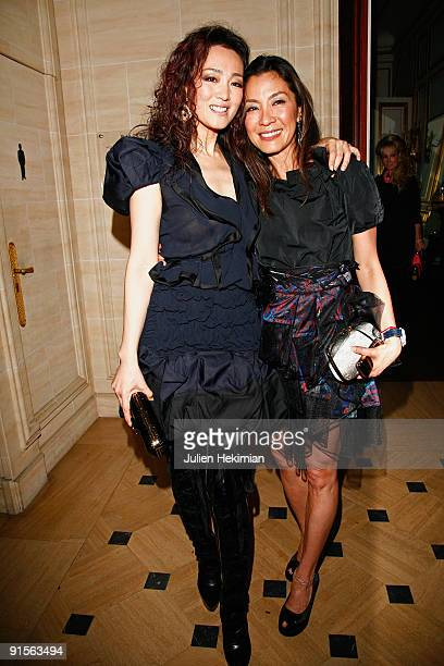 Gong Li and Michelle Yeoh attend the Louis Vuitton party on October 7 2009 in Paris France
