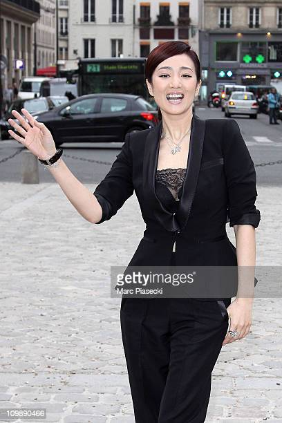 Gong Li arrives at the Louis Vuitton Ready to Wear Autumn/Winter 2011/2012 show during Paris Fashion Week at Cour Carree du Louvre on March 9 2011 in...