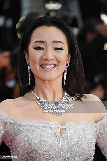 Gong Li attends the 'Cafe Society' premiere and the Opening Night Gala during the 69th annual Cannes Film Festival at the Palais des Festivals on May...