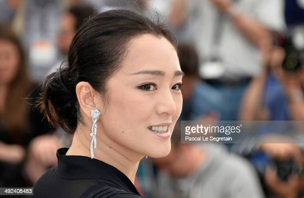 Gong Li attends the Coming Home photocall at the 67th Annual Cannes Film Festival on May 20 2014 in Cannes France