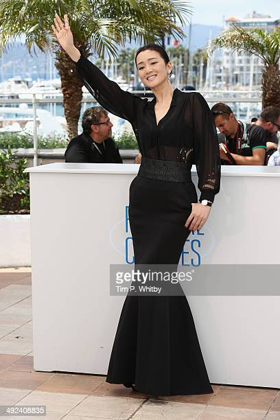 Gong Li attends the 'Coming Home' photocall at the 67th Annual Cannes Film Festival on May 20 2014 in Cannes France