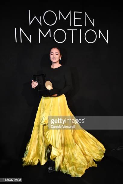 Gong Li attends the Women In Motion Awards at Place de la Castre on May 19, 2019 in Cannes, France.
