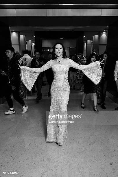 Gong Li departs the Martinez Hotel during the 69th annual Cannes Film Festival on May 11 2016 in Cannes