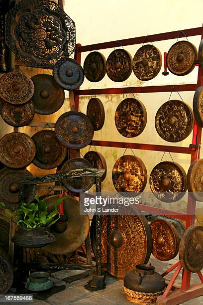 Gong shop in Hoi An. Many boutiques specialize in one kind or another of arts, crafts, antiques or reproductions..