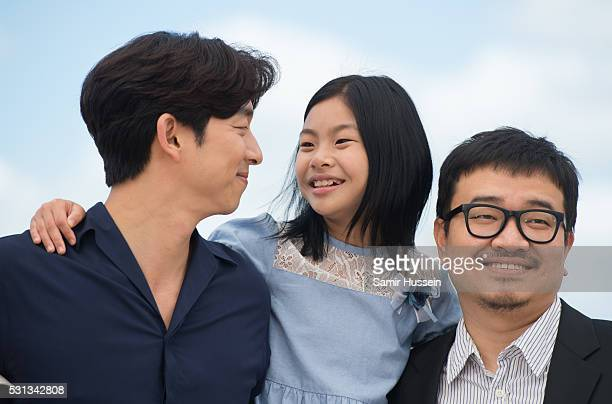 """Gong Yoo, Kim Su-an and director Yeon Sang-ho attend the """"Train To Busan """" Photocall at the annual 69th Cannes Film Festival at Palais des Festivals..."""