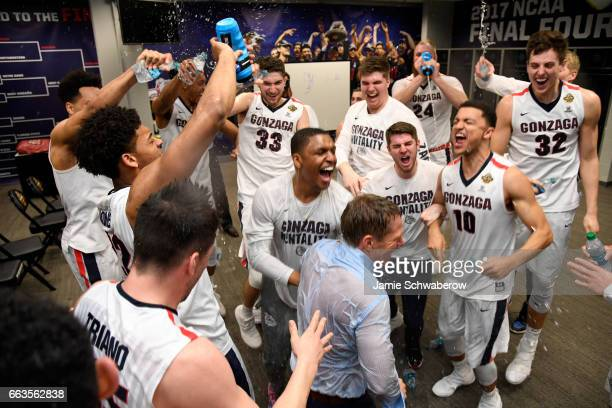 Gonzaga Bulldogs basketball team members celebrate after winning during the 2017 NCAA Men's Final Four Semifinal against the South Carolina Gamecocks...