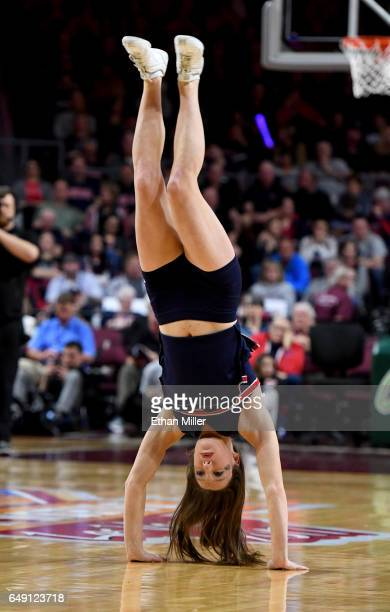 Gonzaga Bulldogs cheerleader flips in the air during the team's semifinal game of the West Coast Conference Basketball Tournament against the Santa...
