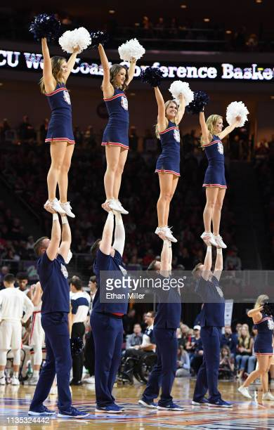 Gonzaga Bulldogs cheerleaders perform during a semifinal game of the West Coast Conference basketball tournament against the Pepperdine Waves at the...