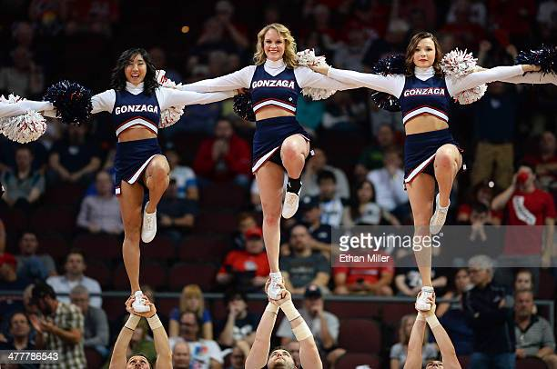 Gonzaga Bulldogs cheerleaders perform during a semifinal game of the West Coast Conference Basketball tournament against the Saint Mary's Gaels at...