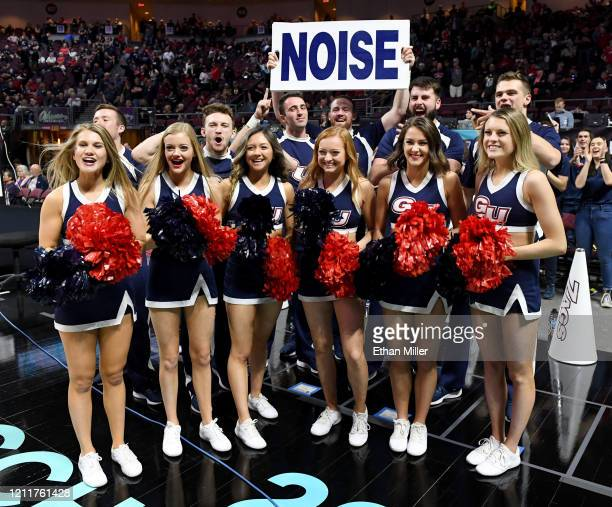 Gonzaga Bulldogs cheerleaders pose for a television camera before the team's game against the Saint Mary's Gaels in the championship game of the West...