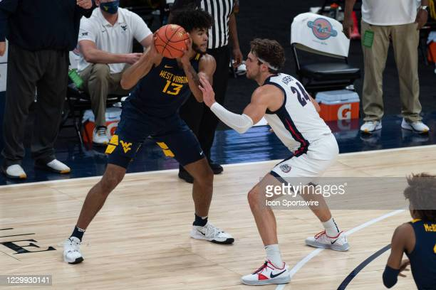 Gonzaga Bulldogs forward Corey Kispert defends West Virginia Mountaineers forward Isaiah Cottrell during the men's Jimmy V Classic college basketball...