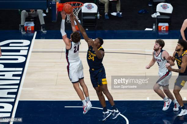 Gonzaga Bulldogs forward Corey Kispert goes up for a layup against West Virginia Mountaineers forward Oscar Tshiebwe during the men's Jimmy V Classic...