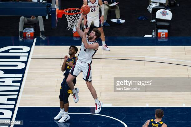 Gonzaga Bulldogs forward Drew Timme drives by West Virginia Mountaineers guard Taz Sherman for a score during the men's Jimmy V Classic college...