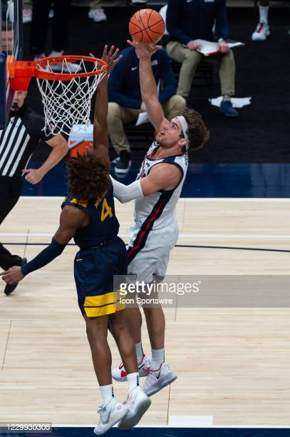 Gonzaga Bulldogs forward Drew Timme scores inside against West Virginia Mountaineers guard Miles McBride during the men's Jimmy V Classic college...