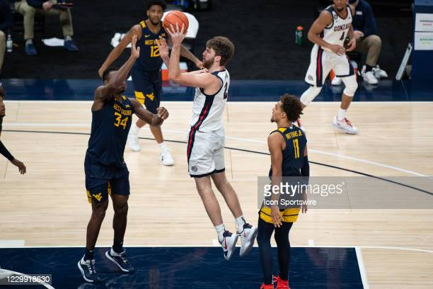 Gonzaga Bulldogs forward Drew Timme scores over West Virginia Mountaineers forward Oscar Tshiebwe in the lane during the men's Jimmy V Classic...